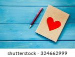 Love Heart On Notebook With Pe...