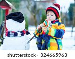 adorable kid boy making a... | Shutterstock . vector #324665963