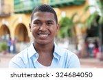happy guy in a blue shirt in a... | Shutterstock . vector #324684050