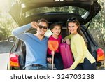 a smiling family looking at... | Shutterstock . vector #324703238