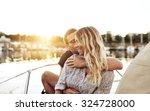 loving couple enjoying life... | Shutterstock . vector #324728000