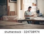 male entrepreneur craftsman... | Shutterstock . vector #324738974