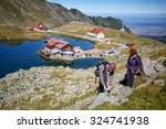 Hikers With Backpacks By The...