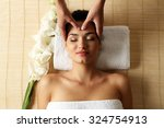 young woman in beauty spa salon ...   Shutterstock . vector #324754913