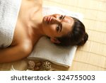 portrait of young woman while... | Shutterstock . vector #324755003