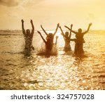 silhouettes of young group of... | Shutterstock . vector #324757028