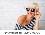 cheerful girl with glasses... | Shutterstock . vector #324770738