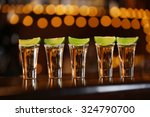 shot glasses with tequila on... | Shutterstock . vector #324790700