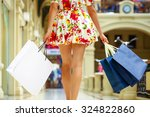 legs of shopaholic wearing red... | Shutterstock . vector #324822860