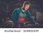mechanic checking under hood in ... | Shutterstock . vector #324833339