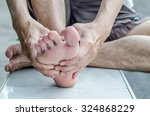 man's hand being massaged a foot | Shutterstock . vector #324868229