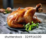 roasted chicken on gray plate | Shutterstock . vector #324916100