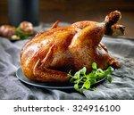roasted chicken on gray plate | Shutterstock . vector #324916100
