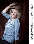 woman in hat retro portrait. | Shutterstock . vector #324916460