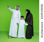Emirati Family Looking With...