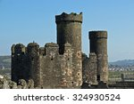 conwy castle with stone walls...