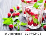 cocktail with raspberry and... | Shutterstock . vector #324942476