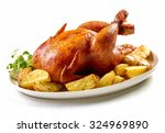 roasted chicken and potatoes on ... | Shutterstock . vector #324969890