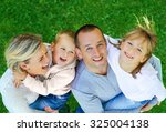 happy family on a background of ... | Shutterstock . vector #325004138