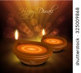 illustration of burning diya on ... | Shutterstock .eps vector #325009868