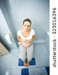 young sad pregnant woman...   Shutterstock . vector #325016396