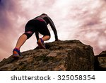 woman hiking and climbing over... | Shutterstock . vector #325058354