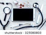 tablet pc with medical objects... | Shutterstock . vector #325080803