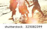 family beach football holiday... | Shutterstock . vector #325082399