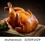 roasted chicken on wooden... | Shutterstock . vector #325091429