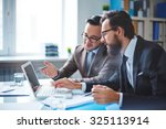 two employees discussing... | Shutterstock . vector #325113914