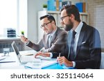 two employees planning work and ... | Shutterstock . vector #325114064