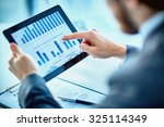 businessman pointing at chart... | Shutterstock . vector #325114349