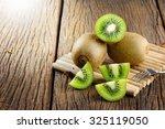 closeup kiwi fruit on wooden... | Shutterstock . vector #325119050