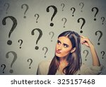portrait confused thinking... | Shutterstock . vector #325157468