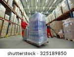 warehousing   two workers in... | Shutterstock . vector #325189850