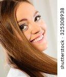 closeup young smiling woman... | Shutterstock . vector #325308938