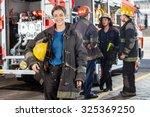 Portrait Of Happy Firewoman...