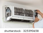 cleaning of air conditioning | Shutterstock . vector #325390658
