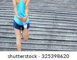 fitness woman runner stretching ... | Shutterstock . vector #325398620