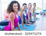 portrait of women doing cobra... | Shutterstock . vector #325471274