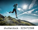 female running in mountains... | Shutterstock . vector #325472588