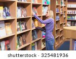 young woman selecting book from ... | Shutterstock . vector #325481936