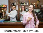 happy female drinking wine at... | Shutterstock . vector #325494836