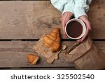 Female Hands Holding Cup Of...