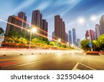 light trails on the street in... | Shutterstock . vector #325504604