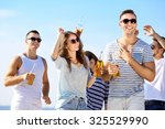 young people with beer on the...   Shutterstock . vector #325529990