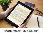 hands of a man holding a book...   Shutterstock . vector #325538504