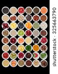 Small photo of Large superfood selection in porcelain crinkle bowls over black background. High in vitamins and antioxidants.