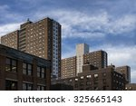 Urban cityscape dominated by public housing complexes, along 9th Avenue. Chelsea, Manhattan.