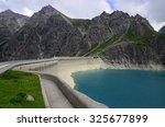 dam  reservoir  lake  alps ... | Shutterstock . vector #325677899